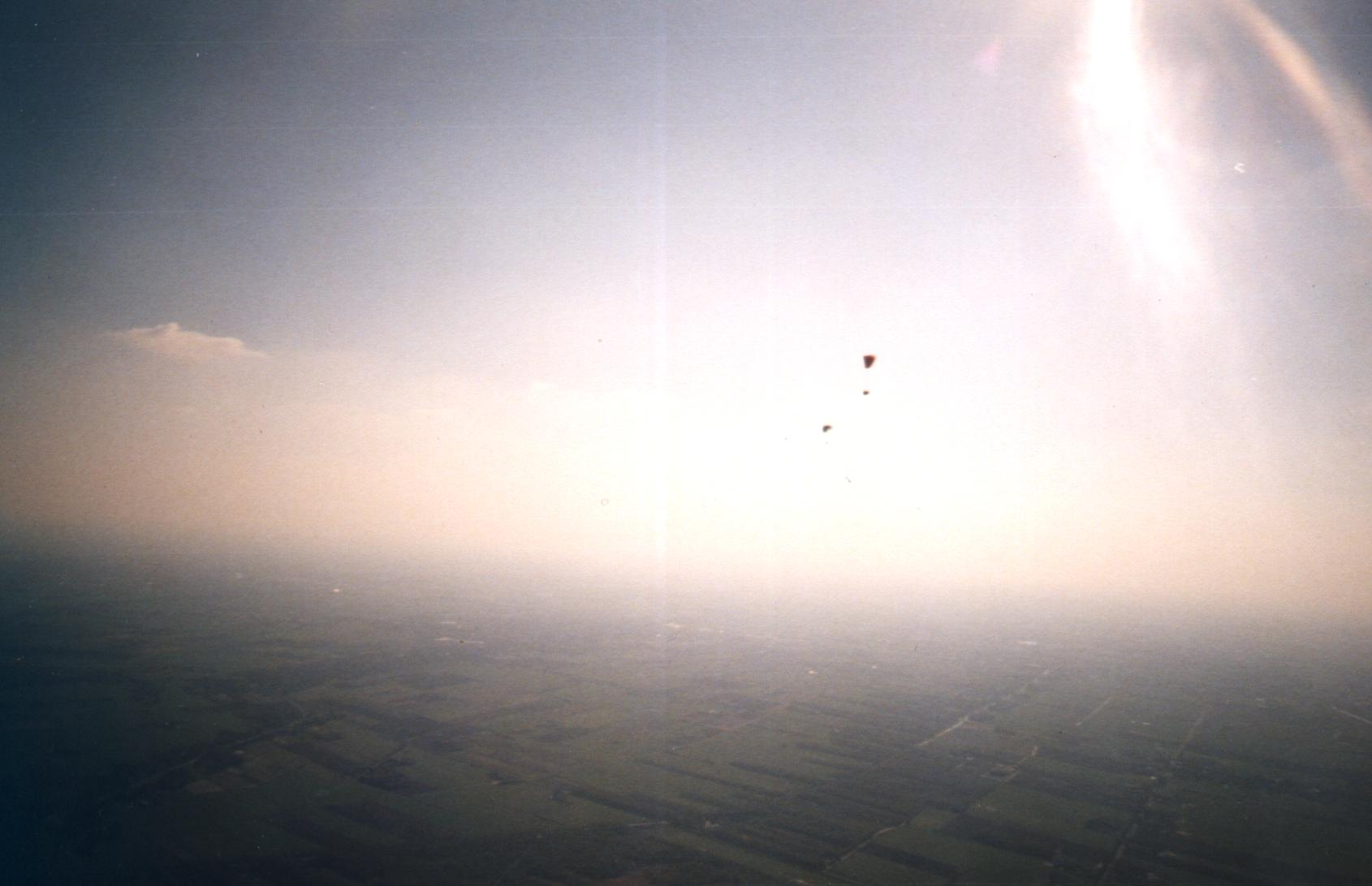 2 paragliders thermalling above the marsh